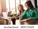 female coworkers working... | Shutterstock . vector #589176569
