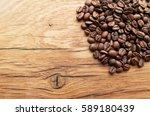 coffee beans on grunge wooden... | Shutterstock . vector #589180439