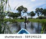 mokoro ride in the okavango...   Shutterstock . vector #589190123