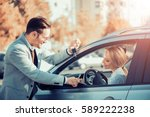 car dealership.young woman... | Shutterstock . vector #589222238