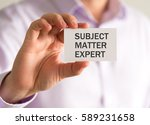 Small photo of Closeup on businessman holding a card with SUBJECT MATTER EXPERT message, business concept image with soft focus background and vintage tone