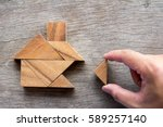 wooden tangram puzzle wait to... | Shutterstock . vector #589257140