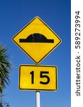 Small photo of Actual sign board of advisory speed limit of 15 kilometer per hour and road bump