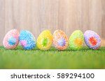 artificial color eggs on green... | Shutterstock . vector #589294100