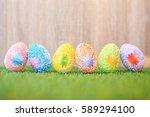 artificial color eggs on green... | Shutterstock . vector #589294100