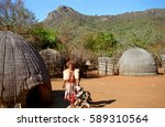 Small photo of SWAZILAND - JULY 15: Sangoma in front of his hut on 15 July 2000 at Swaziland. Sangoma is the shaman, healer and magicician in Swazi and Zulu culture.