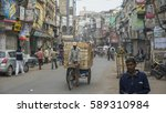 Small photo of DELHI, INDIA - NOV 18: A classical street and old buildings in Old Delhi. November 18, 2012 in Delhi, India. The lifestyle in old delhi is still well kept like that in 100 years ago.