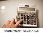 Woman Hand Using Calculator.