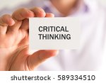 Small photo of Closeup on businessman holding a card with CRITICAL THINKING message, business concept image with soft focus background and vintage tone
