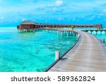 tropical beach in maldives with ... | Shutterstock . vector #589362824