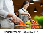 restaurant worker cutting fresh ...   Shutterstock . vector #589367414