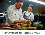 chef and his trainee cooking...   Shutterstock . vector #589367438