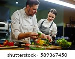 chef consulting his trainee... | Shutterstock . vector #589367450