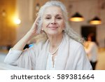 serene grandmother looking at... | Shutterstock . vector #589381664