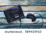 Small photo of CLEETHORPES, UK - February 28 2017: A studio shot of a Sega Mega Drive game console, a 16-bit video games machine that was popular in the late 80s and early 90s