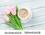 Pink Tulips And Coffee Cup On...