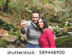 young couple hiking taking...   Shutterstock . vector #589448900