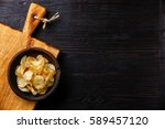 homemade crispy potato chips on ... | Shutterstock . vector #589457120