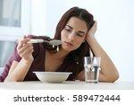 Depressed Woman Sitting At...