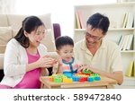 asian parent playing building... | Shutterstock . vector #589472840