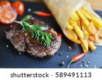French Fries And Steak On Plate