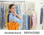 female worker in dry cleaning... | Shutterstock . vector #589543580