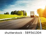 asphalt road on dandelion field ... | Shutterstock . vector #589561304