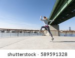 women running on bridge | Shutterstock . vector #589591328