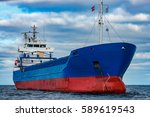 Blue Cargo Ship Moored In Still ...