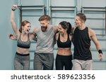 smiling sporty men and women in ... | Shutterstock . vector #589623356