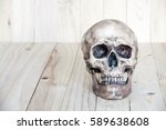human skull on wood background | Shutterstock . vector #589638608