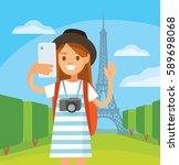 traveler girl makes selfie by...   Shutterstock .eps vector #589698068