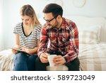 leisurely couple in love... | Shutterstock . vector #589723049