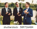 groom in blue suit and... | Shutterstock . vector #589726484