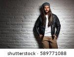 man with long hair standing... | Shutterstock . vector #589771088