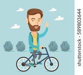 caucasian sportive man riding a ... | Shutterstock .eps vector #589803644