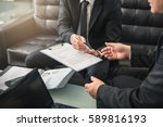 two business partners signing a ... | Shutterstock . vector #589816193