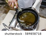 chef fried rosemary leaves in... | Shutterstock . vector #589858718