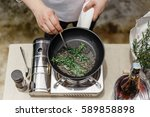 chef fried rosemary leaves in... | Shutterstock . vector #589858898
