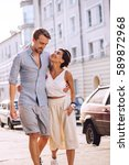 two in love walking in city at... | Shutterstock . vector #589872968