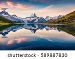 Colorful summer sunrise on Bachalpsee lake with Schreckhorn and Wetterhorn peaks on background. Picturesque morning scene in the Swiss Bernese Alps, Switzerland, Europe.  - stock photo