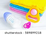 baby bottle with milk and towel ... | Shutterstock . vector #589899218