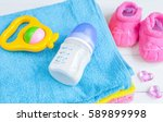 baby bottle with milk and towel ... | Shutterstock . vector #589899998