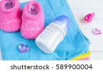 baby bottle with milk and towel ... | Shutterstock . vector #589900004