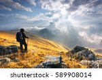 man standing on a mountain... | Shutterstock . vector #589908014