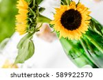 Centerpiece With Sunflowers An...