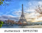 eiffel tower at sunset in paris ... | Shutterstock . vector #589925780
