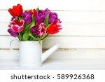 tulip bouquet on  wooden... | Shutterstock . vector #589926368