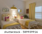 Small photo of Colorful Guest Bedroom with twin beds