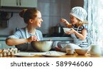 happy family in the kitchen.... | Shutterstock . vector #589946060